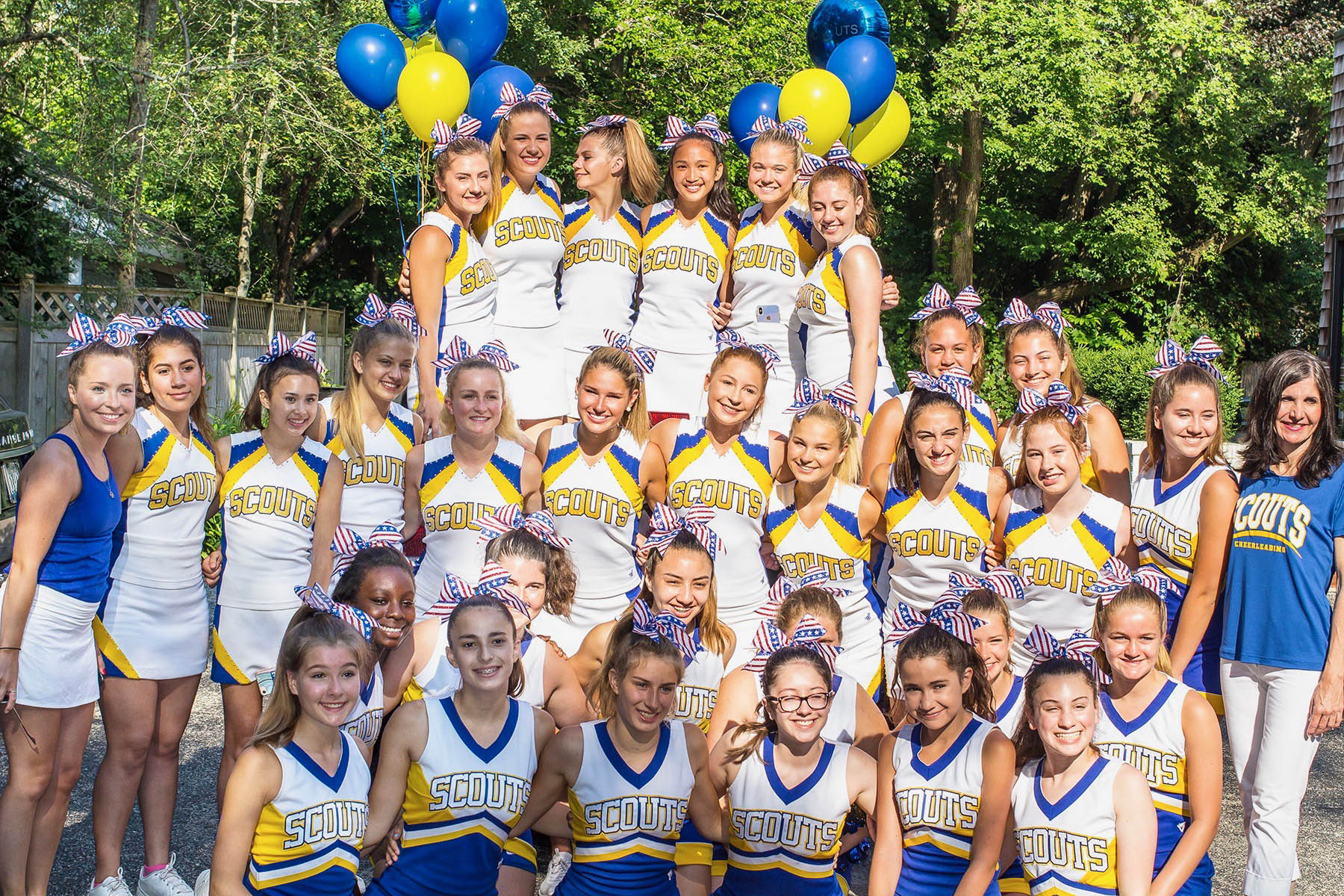 Varsity and JV Cheerleading Teams participate in Fourth of July parade