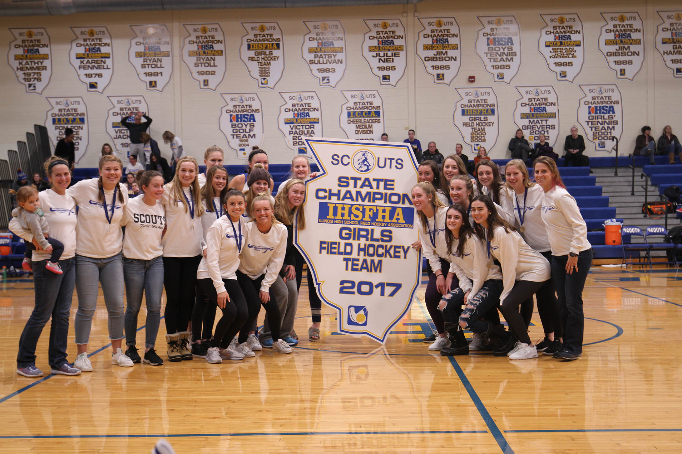 State Champion Girls Field Hockey receive state board at girl's basketball game on December 14, 2017